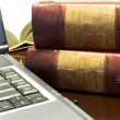 Stock Photo: Laptop and Legal books on table