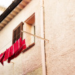 Washing line in front of a window in Antibes, France - 图库照片