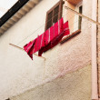 Washing line in front of a window in Antibes, France — Stock Photo