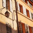Old Fashioned Lantern in a French town - Stock Photo
