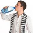 Stock Photo: Mwith white pinstripe shirt and scarf with bottled water in hand.