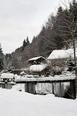 Small Snowcovered firewood barn in the German Alps — Stock Photo