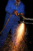 Worker in Blue safety overalls working with Plasma cutter — Stock Photo