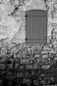 An old locked window in the famous Ile Sainte Marguerite Island Jail, across from Cannes, France — Stock Photo