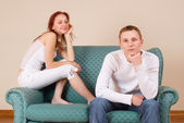 Woman and boyfriend sitting on couch — Stock Photo