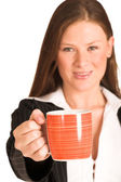Business woman dressed in a pinstripe suit, holding a mug — Stock Photo