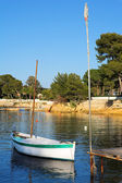 A small boat floating in Antibes, France — Stock Photo