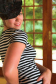 Modern Dancer in black Hat and striped top — Stock Photo