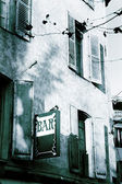 Building and signboard of Bar in Antibes, France. — Stock Photo