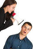 A brunette woman yelling at her male business partner over a microphone — Stock Photo
