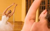 Ballerina dancing in front of mirror — Stock Photo