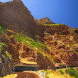 The winding road on Chapmans Peak, South Africa through the half tunnel — Stock Photo