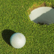 Stock Photo: A golf ball on a green.