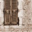 Window shutters and an old building in Antibes, France. — Stock Photo
