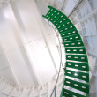 Green metal spiral staircase inside a white walled lighthouse — Stock Photo #22122199