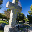 Old stone Grave in the shape of a cross at the Belvedere Church, Knysna, South Africa - Stock Photo