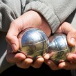 The hands of a man holding Petanque (boule) balls — Stock Photo #22122699