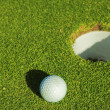 Stock Photo: A golf ball on a green