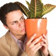 Businessman holding a pot plant — Foto de stock #22123885