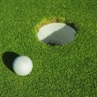 A golf ball on a green — Stock Photo