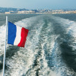 Stock Photo: Leaving Harbour in Cannes, on speedboat - French flag