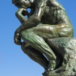 A copy of the famous bronze sculpture of Auguste Rodin The Thinker - Stock Photo