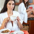 Sexy young adult brunette roommates in lingerie eating breakfast — Stock Photo #22124315