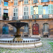 Stock Photo: Courtyard with a fountain in Aix-en-Provence, France.