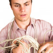 Businessman tangled up in a electric cable — Stock Photo