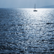 A sailboat sailing at sunset inAntibes, France — Stock Photo