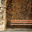 Old bench in the Original Harbour blocking wall at Baie Des Anges in Antibes, France — Stock Photo #22125013
