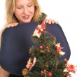 Blond Business Woman, looking down at Christmas Tree — Stock Photo #22125239