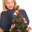 Blond Business Woman, looking down at Christmas Tree — Stock Photo
