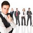 Stock Photo: Formal businessmwearing pinstripe suit, standing in front of group of business
