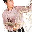 Businessman tangled up in an extension cord. — Stock Photo #22125629