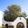 Old watermill next to winery on Plaisir de Merle, South Africa, on a sunny summers day — Stock Photo #22125687