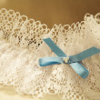 Close-up of a wedding garter. - Stock Photo