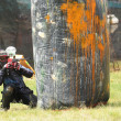Paintball player on an Extreme airball field - Stock Photo