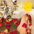 Feet of a person in a bath. - Stock Photo