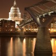 St Paul's Cathedral, accross the River Thames, next to the Millenium Brifge - Stock Photo