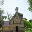 Stock Photo: Old church in Knysna, South Africa, with a cemetery in green gardens