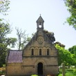 Old church in Knysna, South Africa, with a cemetery in green gardens — Stock Photo