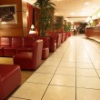 The interior of a hotel with tiled floors and leather couches in Paris, France. - Stock Photo