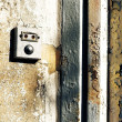 Doorbell with antique wall - Stock Photo