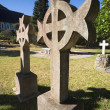Stock Photo: Irish Cross shaped old headstone of grave made from granite