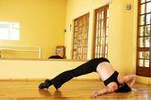 A Female Dancer practicing in her studio — Stock Photo