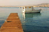 Old fishing boat next to the pier of Ile Sante-Marguerite Cannes in Background, France — Stock Photo