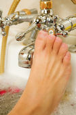 Foot of a woman in a bath. — Stock Photo