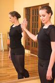 Ballerina standing next to a mirror — Stock Photo