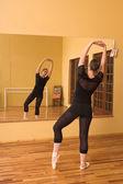 Ballerina dancing in studio — Stock Photo
